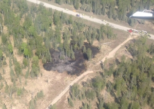 The Escape Route Road Fire started as a grass fire and spread to nearby spruce trees in Nikiski on Thursday, May 28, 2015. Division of Forestry dispatched engines, helitack, Prevention and air attack to work with Nikiski Fire Department to supress the fie. The .83 acres fire is contained, controlled and placed in monitor status. The fire was caused by an exploding shooting target. Jason Jordet Division of Forestry photo