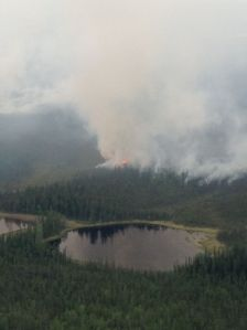 Smoke rises from the 9,000-acre Chisana River 2 Fire burning in the Wrangell-St. Elias National Park and Preserve and the Tetlin National Wildlife Refuge in this photo taken Thursday, June 11, 2015. The fire is approximately 20 miles south of the Alaska Highway and about 25 miles west of the Canadian border. Alaska Division of Forestry photo.