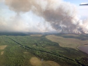 The Card Street Fire burns towards Skilak Lake, right, on Wednesday, June 17, 2015. The fire grew by 6,000 acres Wednesday night. It is now 9,000 acres. Jason Jordet/Alaska Division of Forestry photo.