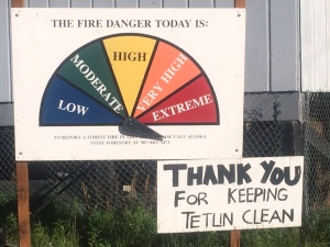 An Alaska Division of Forestry fire danger sign in the community of Tetlin south of Tok sums up the current fire danger in Alaska.