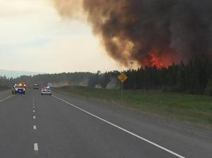 A photo of the Sockeye Fire north of Willow. The fire has jumped the Parks Highway and the road is currently shut down at 77 Mile. The latest size estimate was approximately 120 acres at 3:30 p.m. Photo courtesy of Matanuska-Susitina Borough.