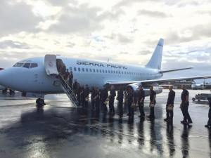 The Alaska Division of Forestry's Gannett Glacier Type 2 Initial Attack Crew boards a jet in Anchorage on Monday, Aug. 10, 2015 bound for northern California to aid in firefighting efforts in the Pacific Northwest.
