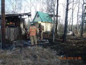 Firefighters in the Mat-Su Valley responded to an escaped burn barrel fire that destroyed a shed near Wasilla on Monday. Photo by Ethan Eley/Division of Forestry