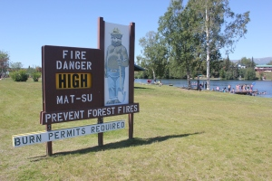 An Alaska Division of Forestry fire prevention sign on the beach at Lake Lucille in Wasilla on Wednesday sums up the current fire danger situation in much of the state. Photo by Tim Mowry/Alaska Division of Forestry