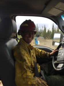 Alaska Division of Forestry firefighter Jenny Moser sits behind the wheel of engine C-61 while working on the Tetlin River Fire near Tok. Photo by Carrie Hale/Alaska Division of Forestry