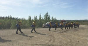 The Upper Tanana #1 Crew heads out to the fire  line on Sunday morning at the Tetlin River Fire south of Tok. The Upper Tanana #1 Crew is one of four crews currently working on the fire and three more crews are scheduled to arrive today. Photo by Sarah Saarloos/Alaska Division of Forestry