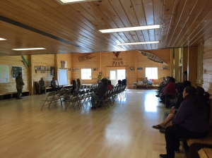 Residents from the community of Tetlin listen to fire managers give an update on the approximately 1,000-acre Tetlin River Fire on Monday afternoon. Photo by Sarah Saarloos/Alaska Division of Forestry