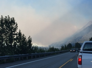 Traffic moves along the Seward Highway early Monday morning. The northbound lane of the highway was closed due to heavy smoke and fire activity from the 200-acre McHugh Fire at approximately 5 a.m. Monday. Photo by Michelle Weston