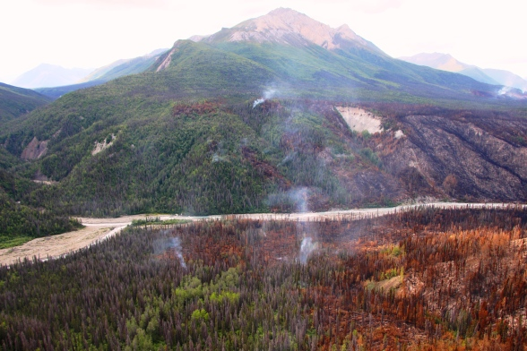The Steamboat Creek Fire smolders near the confluence of the Klu and Chakina Rivers. Photo Credit: Jamie Hart, National Park Service