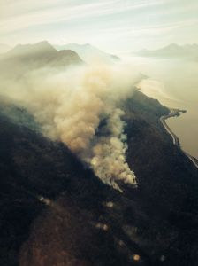 This aerial photo of a 25-acre wildfire burning in the McHugh Creek drainage south of Anchorage off the Seward Highway was taken at approximately 10:30 a.m. Alaska Division of Forestry photo