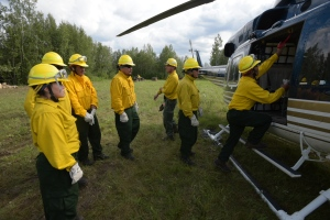 Members of the Fort Yukon #2 crews load into a helicopter to be transported to the 1,170-acre Mid Salcha Fire on Saturday, July 16.