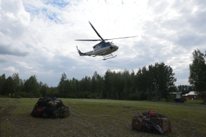 Members of the Fort Yukon #2 crew fly off the Salcha helibase on their way to help fight the 1,170 Mid Salcha Fire on Saturday, July 16. Sam Harrel/Alaska Division of Forestry