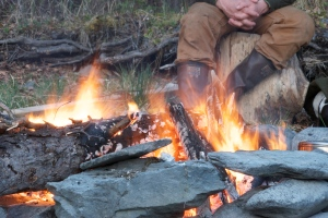 Hunters need to drown their campfires with water and stir them until they are cold to the touch. Beth Ipsen/BLM Alaska Fire Service