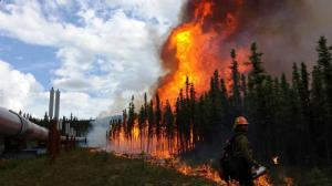A burnout operation on the 31,705-acre Aggie Creek Fire along the trans-Alaska oil pipeline north of Fairbanks on July 16, 2015. Photo by Phillip Spor