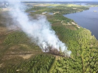 The Call of the Wild Fire (#242) burned on the northwest side of Big Lake. Forestry firefighters are working on mopping up the fire today. Photo by Renette Saba//Alaska Division of Forestry