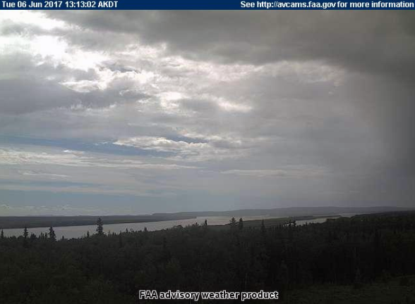 A picture taken from the FAA webcam in Anvik at 1:13 p.m. on June 6, 2017 shows showers south of the village. The Deadmans Slough Fire is burning southwest of Anvik.