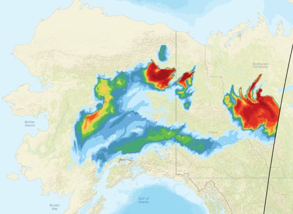 This image shows the extent of the smoke spreading Tuesday evening from fires burning in the northeastern Interior, Yukon and Northwest territories.