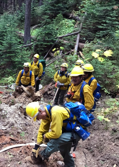 Members of the Type 2 Emergency Firefighter crew from Nulato work on securing line on the Caribou Fire in Montana near the Canadian border. The crew is among the final four of 23 EFF crews that worked on fires in the Lower 48. Photo by Travis McCabe//BLM Alaska Fire Service