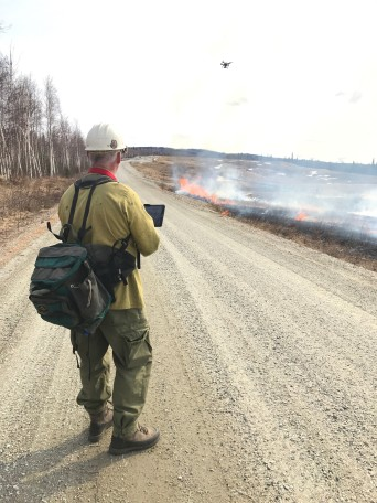 BLM Alaska Aviation Manager Gary Baumgartner operates a unmanned aerial system during a prescribed burn on military training lands on April 30, 2017.