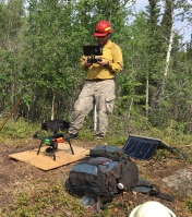 BLM Alaska Fire Service drone pilot Jason Brooks readies the quadcopter for take off before flying over the North Robertson Fire near Tok on June 10, 2017.