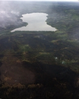 The Zitziana River Fire (#133) was smoldering on the east side (to the left) of the Kindamina Lake Saturday. Conditions moderated Saturday to allow firefighting personnel to fly over the fire and get a good look at it. Photo by Abe Davis, BLM AFS
