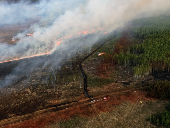 Photo of Firefighters, aided by aircraft and equipment, secured the northwest corner of the fire, seen here on May 17, 2019. Photo by Karen Scholl, Alaska Interagency Incident Management Teamd