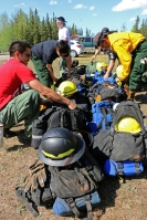 Photo of firefighters from the Type 2 Emergency Firefighter Fairbanks #1 crew get their gear ready to eventually shuttle to the fireline on May 17, 2019. Pictured are, from left to right, Christopher Wright, Mandy Cadzow, Khrystian Simon, Glen Duncan with Blaine Amory and Jayton Titus in back.
