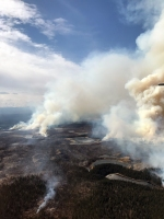 Photo provided by BLM Alaska Fire Service personnel that flew over the fire midday Thursday and reported the fire was backing, creeping and sometimes running in an area that is interspersed with lakes – some of which still had ice.