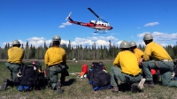 Photo of members of the Division of Forestry's Pioneer Peak Interagency Hotshot Crew wait for their turn to shuttle to the fireline on May 15, 2019.