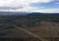 Smoke is visible on the northeast corner in this photo taken on May 11, 2019 while facing south from over the winter trail. The Delta Creek is in the northeast corner. Photo by Branden Kobayashi/Isaiah Fisher, BLM AFS
