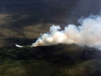 Photo of a Fire Boss airplane dropping water in front of the Kuyukutuk River Fire (#224) on June 14, 2019.