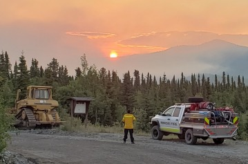 Nikiski Fire Brush Truck  is working closely with a bulldozer putting in a contingency line. Photo:Kassidy Stock, Nikiski Fire
