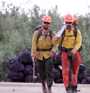 Two members of the Helena Interagency Hotshot Crew prepare to head to the fireline on the Shovel Creek Fire on Thursday, June 27, 2019. Alaska Divvision of Forestry photo