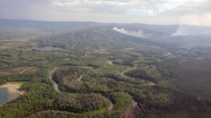 Smoke from the Olnes Pond Fire (#346) as seen from a helicopter carrying firefighers to the fire. Olnes Pond is in the bottom left of the photo. Photo by Ernest Prax/Alaska Division of Forestry
