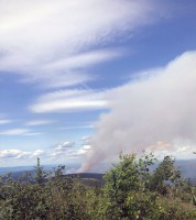 A smoke column rises from the Shovel Creek Fire Tuesday afternoon, June 25, 2019 as viewed from atop Murphy Dome northwest of Fairbanks. Photo by Sarah Saarloos/Alaska Division of Forestry