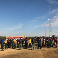 Firefighters gather for the morning briefing for the Shovel Creek Fire near Murphy Dome on Tuesday morning, June 25, 2019. Photo by Sarah Saarloos.