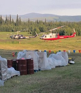Two helicopters sit at the helibase for the Caribou Creek Fire iin Two Rivers on Wednesday, June 26, 2019. The helicopters are used to shuttle crews and supplies in and out of the fire. Photo by Tim Mowry/Alaska Division of Forestry