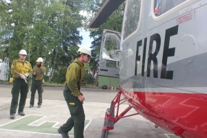 James Lilly, front, and other crew members of the 20-man White Mountain Type 2 Initial Attack Crew, boards a helicopter at Fairbanks Area Forestry on Wednesday, June 19, 2019 to be shuttled in to the Caribou Creek Fire. Photo by Tim Mowry/Alaska Division of Forestry