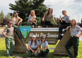 Members of the BLM's 2019 Women's Fire Crew pose for a photo at BLM Alaska Fire Service at Fort Wainwright, Alaska, on July 17, 2019, before heading to the Hadweenzic River Fire. The members of the 2019 crew are: Shelby Descamps, Leah Katz, Patty Derner, Hannah Zamorski, Tess Jarden, Lauren Formiller, Toni Hardy and Alex Perez. CREDIT: BLM Alaska Fire Service