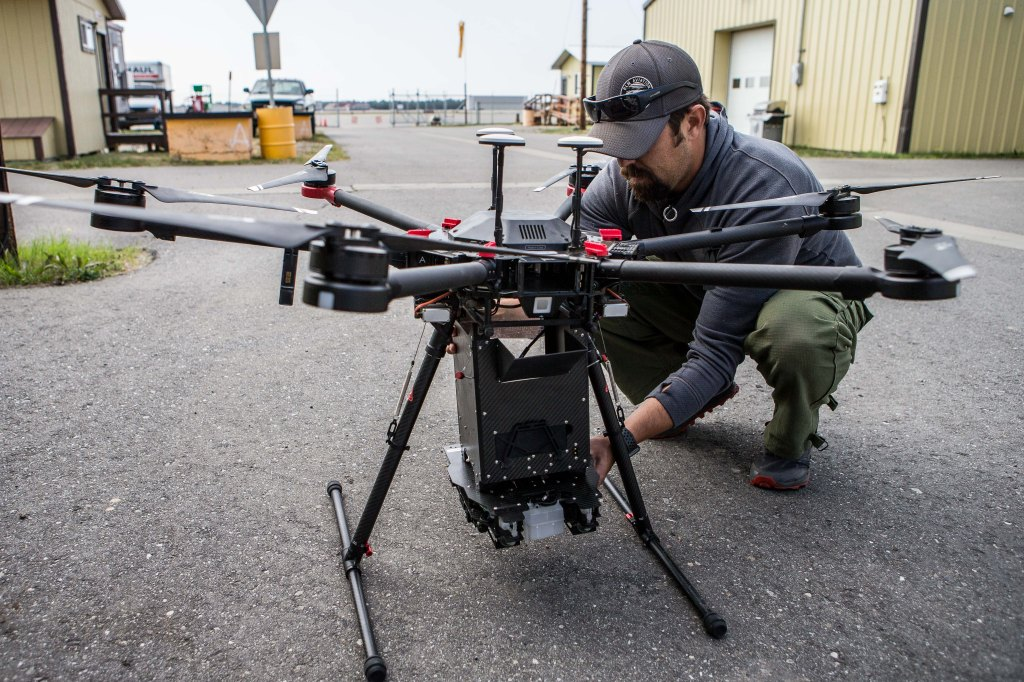 UAS Fire Operations Specialist Justin Baxter prepares the M-600 drone for burnout operations.