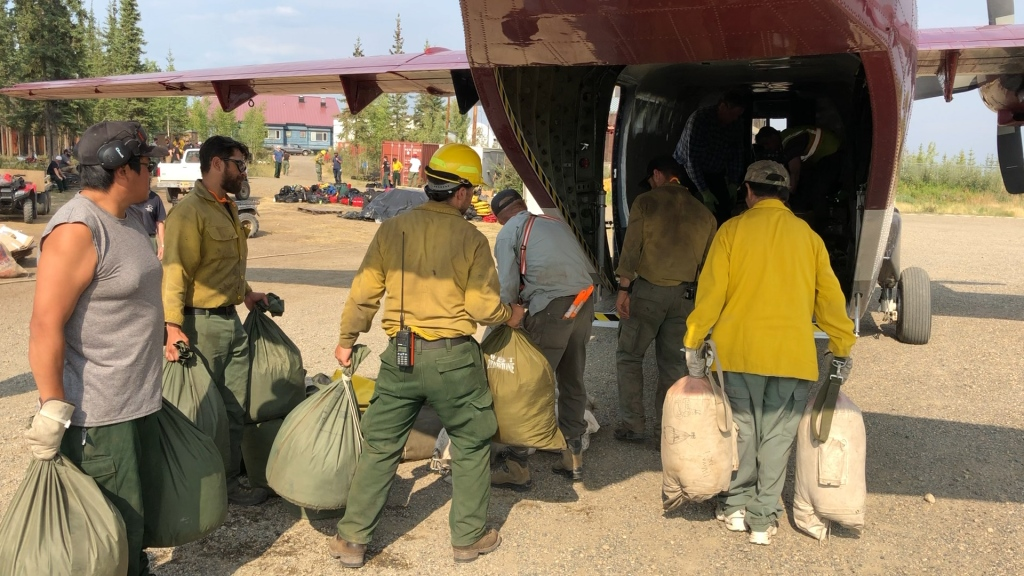 "Fire crews load ""backhaul"" into a support airplane in Chalkyitsik, Alaska. All trash is carefully double bagged with burlap on the outside to protect it as the goal is to limit and reduce the impacts to the remote villages. Photo credit: Kale Casey/Alaska IMT/BLM Alaska Fire Service"