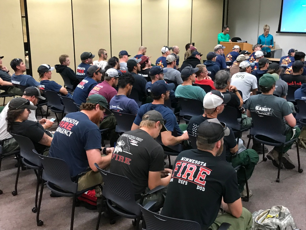 Firefighters sit in a classroom during an orientation session.
