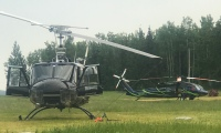 Photo of helicopters parked at the Swan Lake helibase near Sterling.
