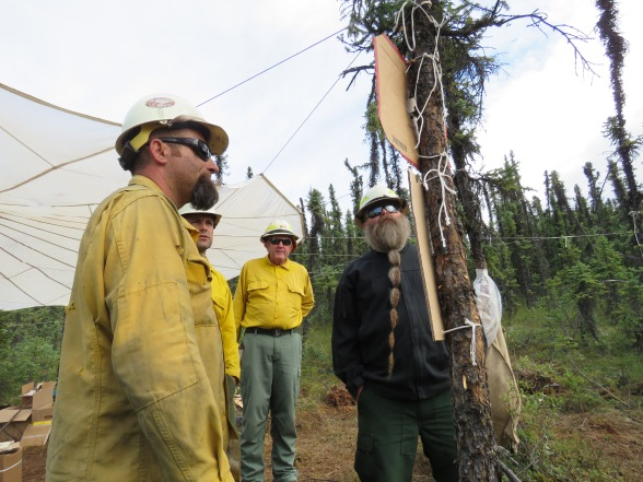 Firefighers managers on the Ninetyeight Creek Fire discussing the fire.
