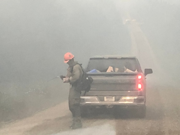 Smoke impacts the fire crews working on Murphy Dome Road.  Photo Credit:Kale Casey/PNW2/DNR Alaska Division of Forestry