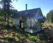 Firefighters add protection wrapping around the historic Harry Johnson cabin on the Kenai National Wildlife Refuge.