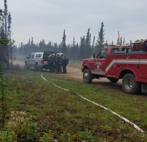 A brush truck from the Anderson Volunteer Fire Department is parked along Kobe Ag Road  near the Kobe Fire on Friday  morning, July 12, 2019 as members of the White Mountain Type 2 Initial  Attack Crew gear up to head to the fire after arriving Friday morning. Photo by Chief Scott Thompson/Anderson Volunteer Fire Department