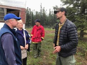 Kobe Fire Operations Section Chief James Ray talks to Denali Borough Mayor Clay Walker, left, and Fairbanks Daily News-Miner reporter Kris Capps on Friday, July 12, 2019. Photo by Chris Noel/Denali Borough