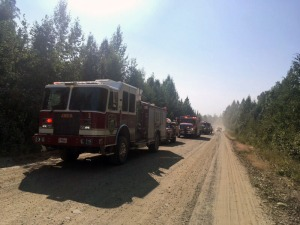 Emergency vehicles from the Matanuska-Susitna Borough are staged along Montana Creek Road to assist with structure protection on the Malaspina Fire on Sunday, July 7,2019. Photo by Brentwood Reid/Alaska Division of Forestry
