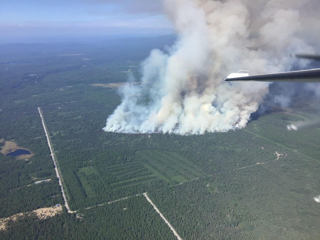 An aerial photo of the Montana Creek Fire taken on initial attack. At 4:30 p.m. the fire was estimated at 30 acres and was burning east of Montana Creek Road near Mile 98 of the Parks Highway. Photo by Jason Jordet/Alaska Division of Forestry